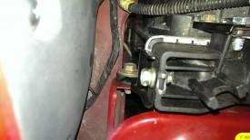 Radiator bolt on the passenger side