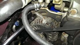 Alternator tension lock bolt
