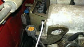 Coil pack mounting bolt on passenger side
