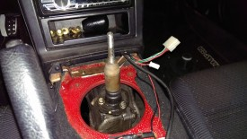 Lower shifter boot has 3 bolts