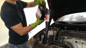 Refilling the coolant with a bugle-sized funnel
