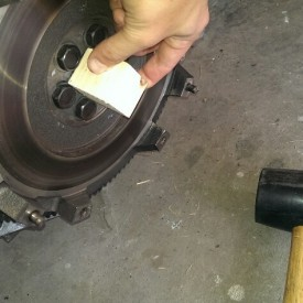 Tapping in the pilot bearing flush with a block of wood