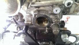 Remove the gasket; note the remaining stud