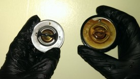 Factory thermostat on left, kit thermostat on right