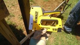 A cheap staple gun helps position the mesh