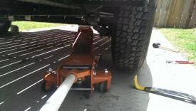 Jack under axle
