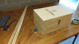 Wine box, test spool of thread, and dowel rod