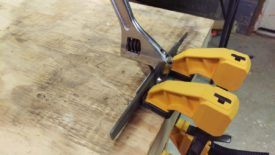 Using clamps and a wrench to bend the angle