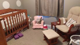 Nursery with crib and table