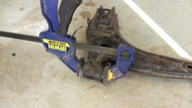 A clamp or bench vise can force the bushings in