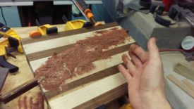 Put glue in the cracks and rub in sawdust