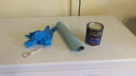 Gloves, shop towels, stain, and a paint can opener
