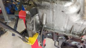 Gently pry the oil pan away from the block