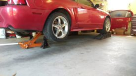 I like to lift the car with the front wheels on wheel ramps and the back wheels on jack stands, making it level