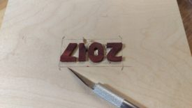 Use the x-acto knife to cut around the letters as deeply as possible