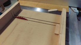 Cutting off with a table saw sled
