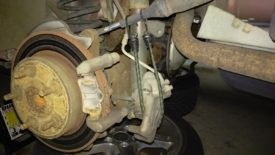 Caliper hanging from a bungee cord to take stress off of the brake line