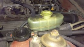 Take the cap off of the brake fluid reservoir