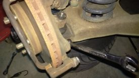The bottom caliper bracket bolt