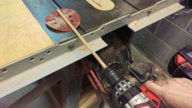 Chuck the dowel rod in the drill, like a bit
