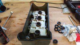 Press the new gasket into the valve cover