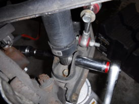 It may be easier to simply remove the coilover